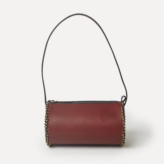 Roule in burgundy calfskin, multicolor laced rope